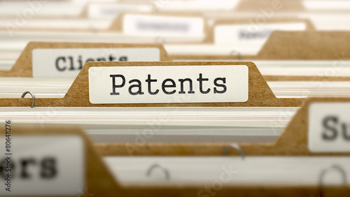 Patents Concept with Word on Folder. - 80648276