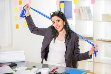 Business woman exercise in her office with stripe stretching