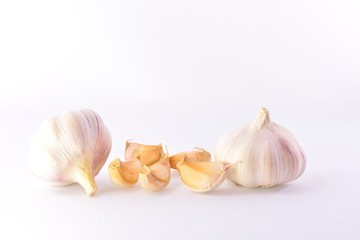Mature garlic and cloves on a white background