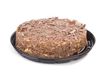 Chocolate cream cake with plastic dish on white