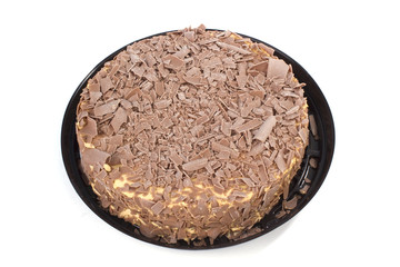Chocolate cream cake with plastic dish on white