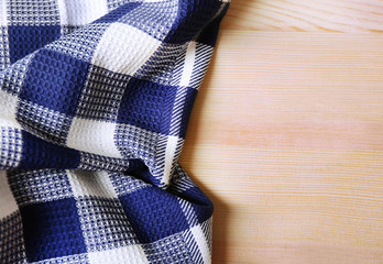 Kitchen towel on wooden background