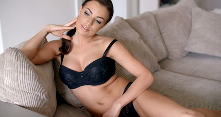 Seductive Woman in Underwear Sitting at the Sofa