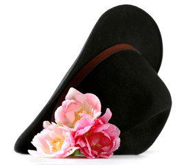 Beautiful tulips with black hat isolated on white