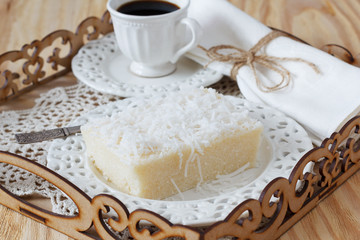 Brazilian dessert sweet couscous pudding coconut, cup of coffee