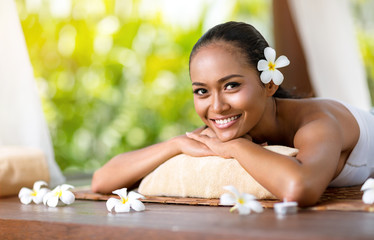 Beautiful smiling woman relaxing after massage