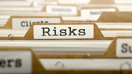 Risks Concept with Word on Folder.