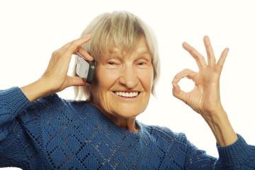 Smiling lady communicating through mobile phone