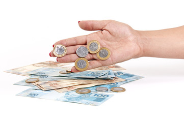 Woman's hand and Brazilian money