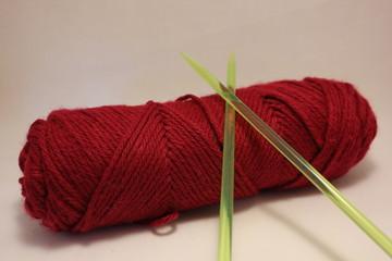 Yarn with plastic knitting needles