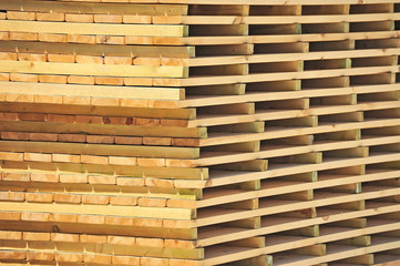 Wooden board for terrace, stacked at construction site