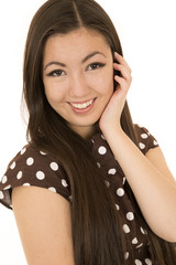 Asian American beauty wearing brown polka dot dress smiling