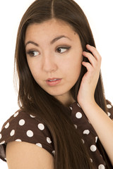 Attractive Asian American woman portrait glancing backwards hand
