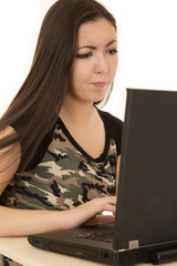 Female student with a frustrated expression using a computer