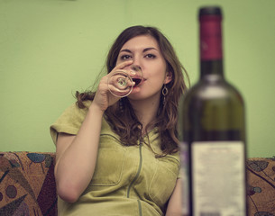 woman in depression, drinking alcohol