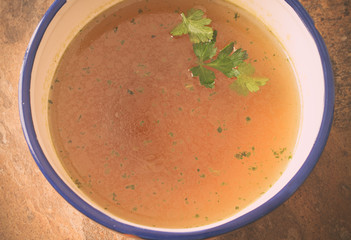 Beef stock with parsley top view