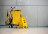Mop bucket and caution sign
