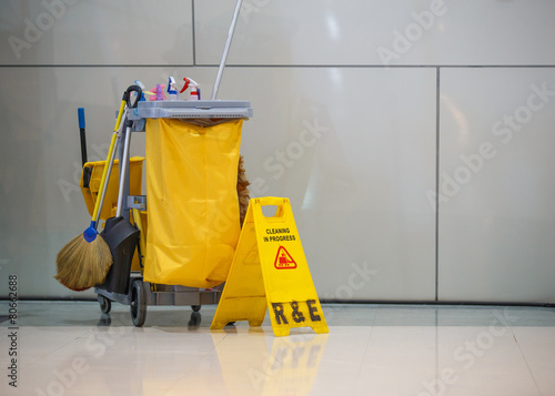 canvas print picture Mop bucket and caution sign
