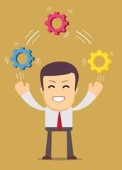 Man juggling with cog wheels, symbolizing strategic thinking