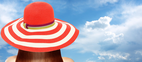 Rear view of young woman in summer hat