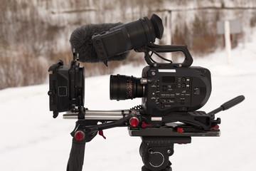 TV camera on a tripod with cinema lenses