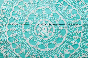 Lace pattern on blue wooden background