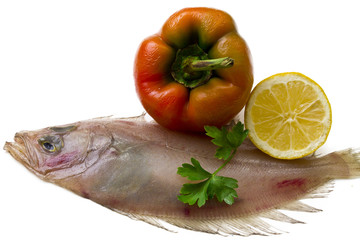 Fresh fish with lemon, parsley and pepper
