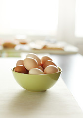 Image of fresh brown chicken eggs in a plate