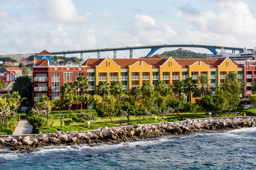 Colorful Resort Beyond Seawall in Curacao