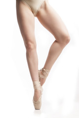 legs in pointe ballerina on white background