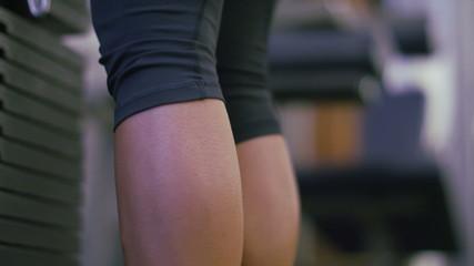 Female doing calf raise exercise in slow motion