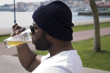 black man on the terrace of a bar