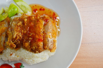 fried chicken on rice cooked in chicken broth
