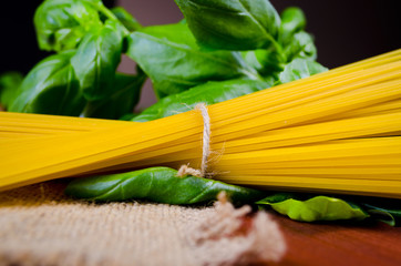 raw spaghetti with basil
