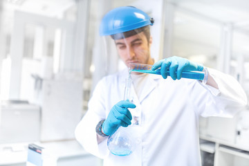 Scientist doctor using laboratory flask for taking samples