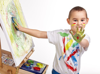 Little boy paints a picture