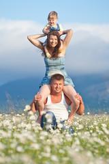 Happy family in flowers field
