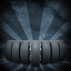 Wedge of new car wheels. Background is concrete surface and