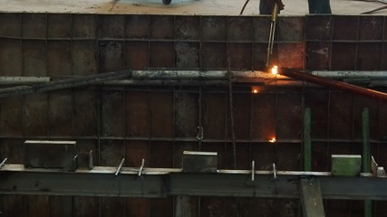 Industrial worker cutting steel by using metal torch, 60 fps.