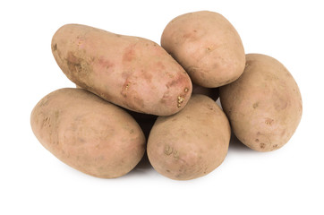 Heap of unwashed raw potatoes