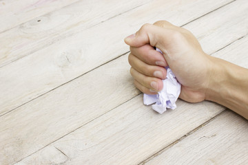 Crumpled paper in hand