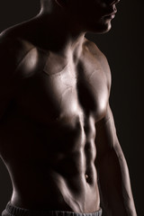 muscular man body with black background