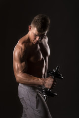 muscle bodybuilder lifting weight