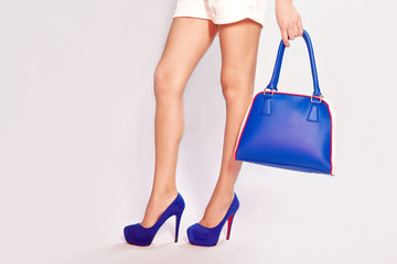 Female feet, shoes and bag