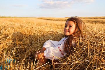 Ukrainian girl in a wheat field