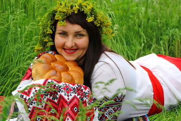 Ukrainian woman with loaf
