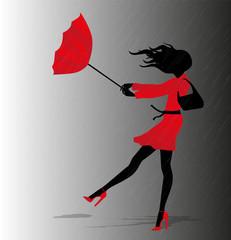 ragazza con ombrello rosso sotto il temporale