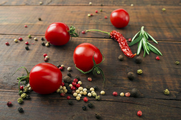 Cherry tomatoes on wooden table, low depth of focus