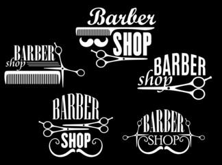 Vintage barber shop emblems on black background