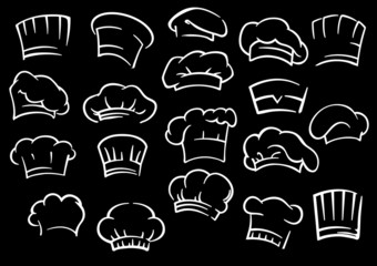 Chef toques or hats on black background